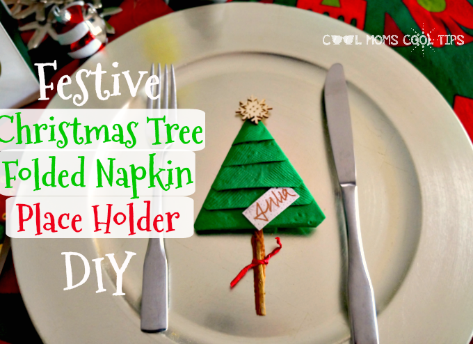 A Party Hosting Table Decor Idea: Christmas Tree Folded Napkin Place Holder DIY